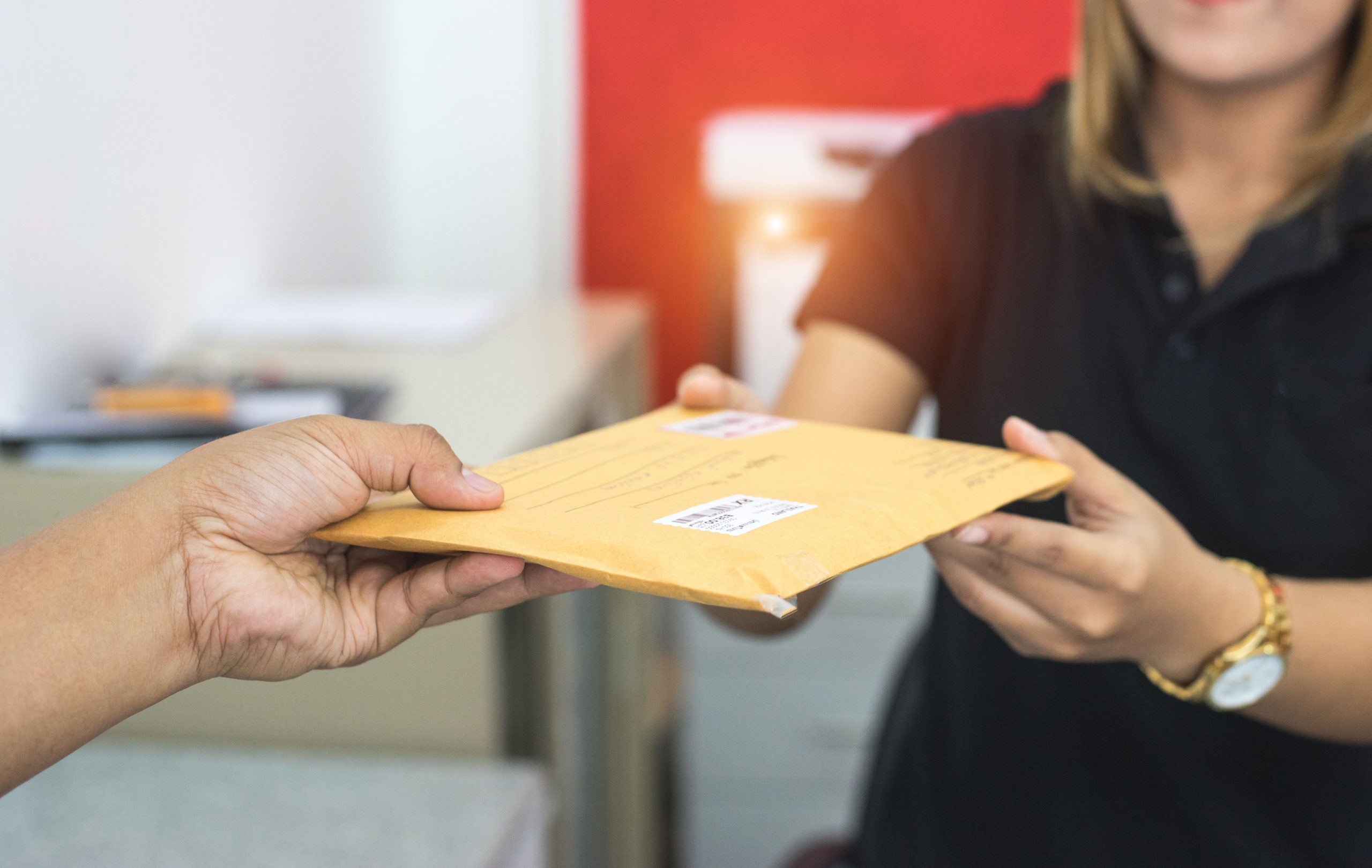 Man Handing Mail | Traditional Mail | Snail Mail Marketing